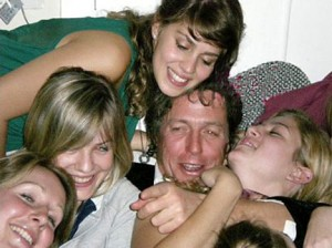 Abom's daughter Candy (in the choke-hold) partying with Hugh in Madrid.